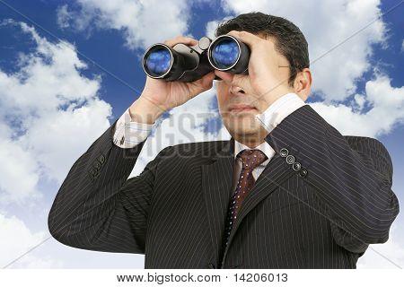 Businessman Looking Through Binoculars