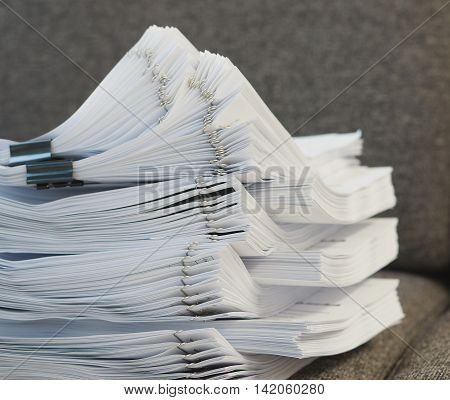 Many Stack Of Document On Sofa At Office