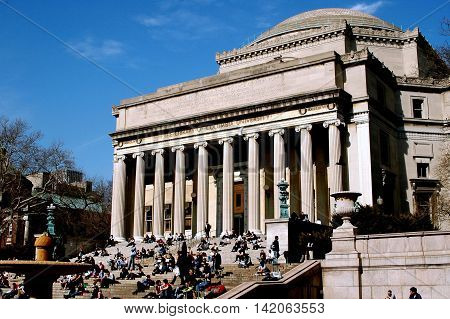 New York City - March 7 2005: Students sitting on the broad staircase in front of the Library of Columbia University on a mild Spring afternoon