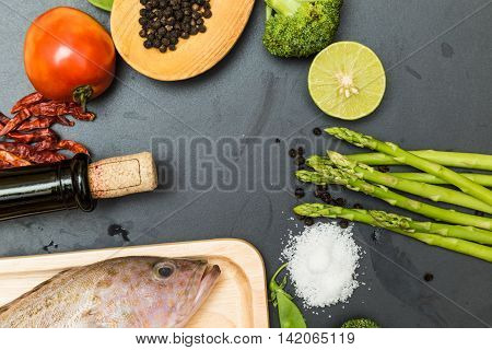 Raw Fish Grouper On Wooden Cutting Board With Asian Spicy Herb And Wine
