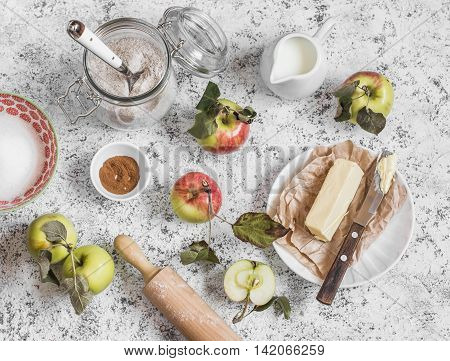 Baking ingredients - whole wheat flour apples butter sugar cinnamon. On a wooden table top view