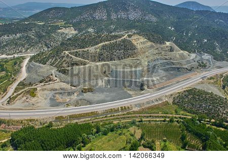 Aerial Photo Road Train mountain valley rock and green