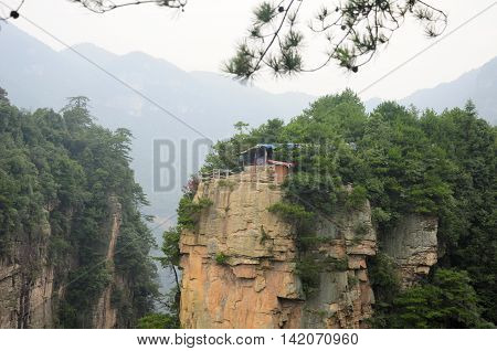 A covered food stand on a cliff within the Zhangjiajie national forest park in Hunan province China.