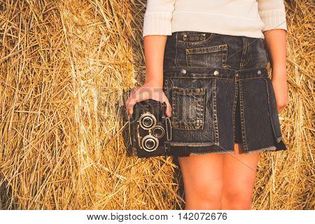 Teen girl holding an old photo camera