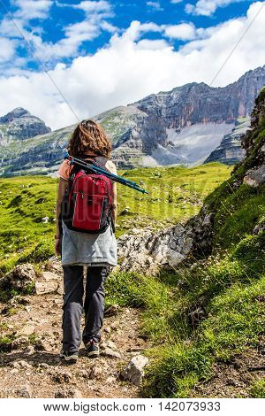 Young Woman doing hiking in a mountain path