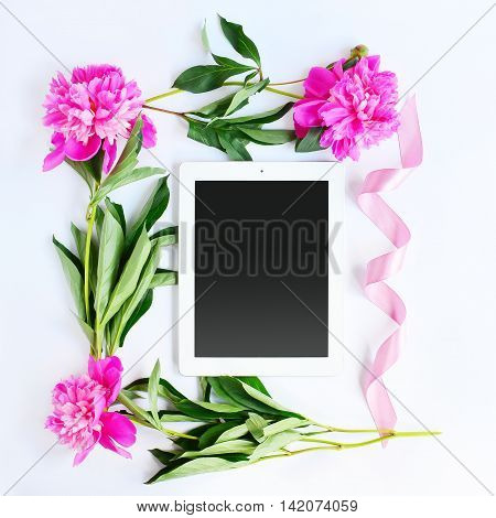 Tablet And Pink Flowers