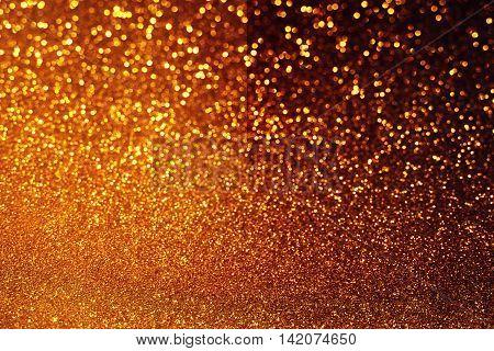 half and half of bright and dark gold glitter bokeh background