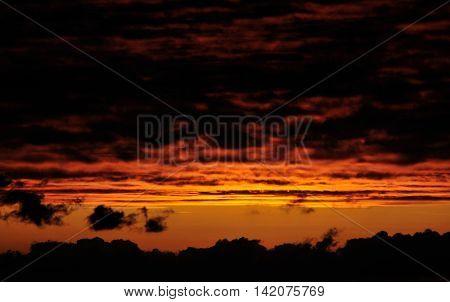 Dark Reddish Skies With Heavy Cloudscape