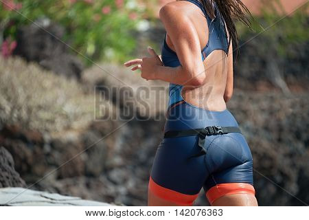 Woman runner running on triathlon race on sunny days