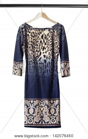 Blue printed dress on wooden clothes rack isolated over white