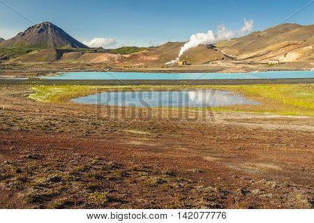 Iceland sunny sumer day. View on Hot springs in Myvatn area.