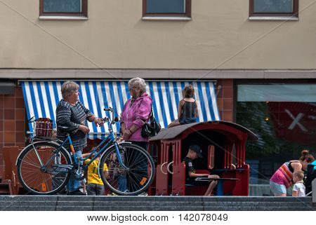 IMATRA FINLAND June 24: A leisurely conversation between two elderly women on the main street of the Finnish town of Imatra 24 June 2016.