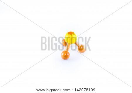 Yellow wood massage device shaped as a knob.