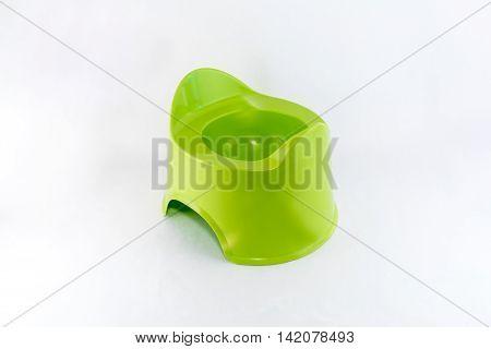 Isolated green toilet potty och white background.