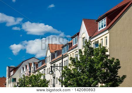 Buildings in Rostock (Germany) with blue sky.