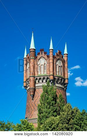 Water tower in Rostock (Germany) with blue sky.