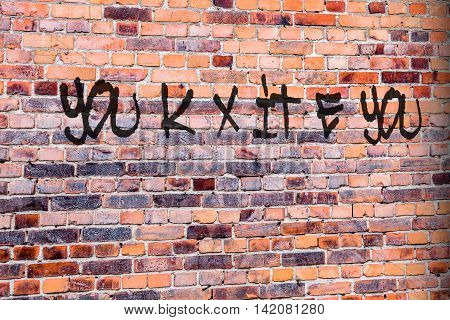Brexit pun writing on brick wall. United Kingdom, UK, leaving the EU.