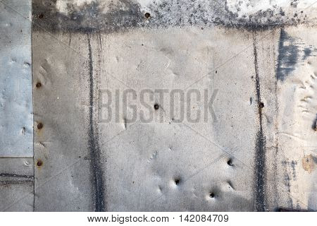 Background of old metal sheets. Metal sheets nailed.