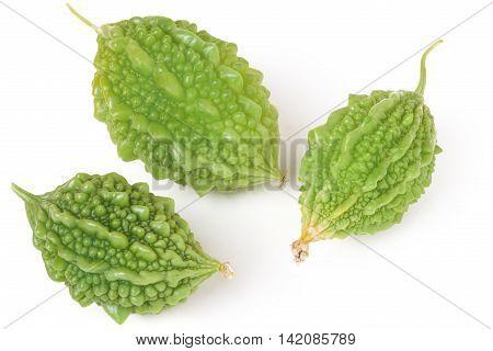 three green momordica or karela isolated on white background.