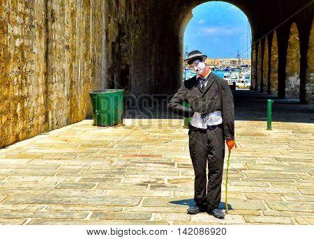 Heraklion Greece - July 19 2013: An actor in makeup clown posing near the port city of Heraklion on the island of Crete Greece.