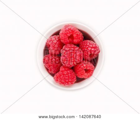 Raspberries in a white ceramic bowl. Berries isolated on white background.
