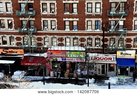 New York City -Janury 24 2016: Snow covers sidewalks and store awnings along upper Broadway in Harlem following a January weekend storm