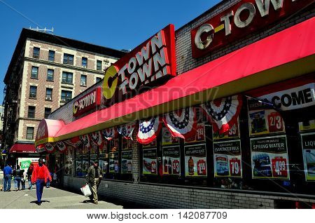 New York City - May 2 2015: C-Town Super Market with patriotic red white and blue bunting on Broadway at West 150th Street