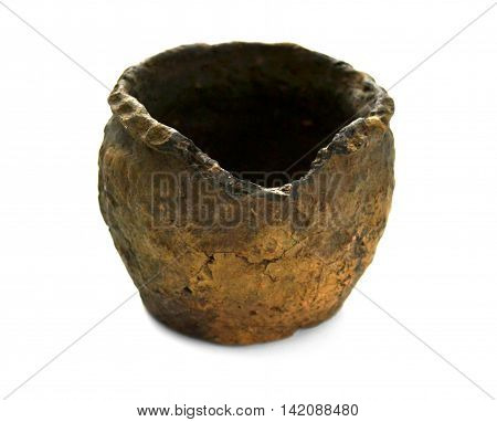 Old clay pot on a white background close-up