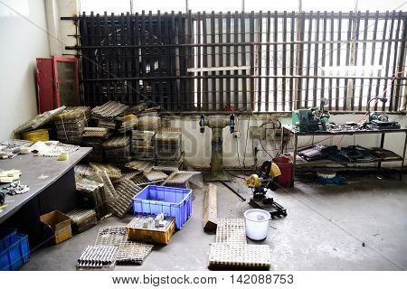 Messy part of workshop at old factory