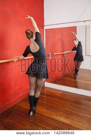 Ballerina Practicing In Front Of Mirror At Studio