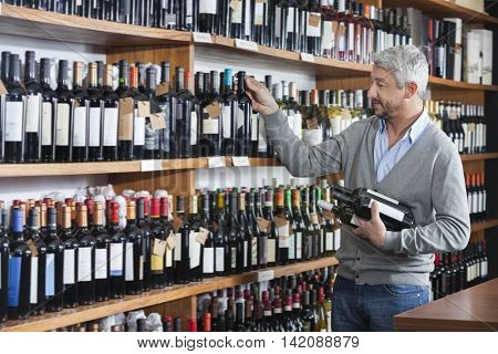 Customer Shopping For Wine Bottles In Store