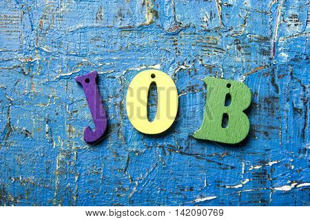 Employment concept with word JOB on abstract blue background.