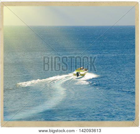 Motorboat crossing ocean vintage photo card effect