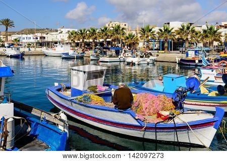 Kos island, Dodecanese, Greece - May 16, 2016: fishing boats in the picturesque harbour village of Kardamena.