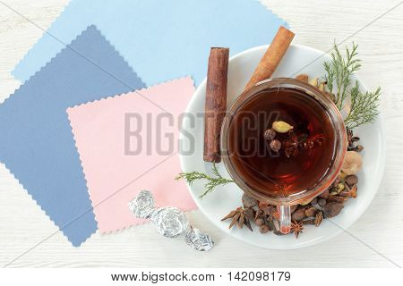 flat layout with tea decorated with different aromatic spices top view / tea flavored with candy