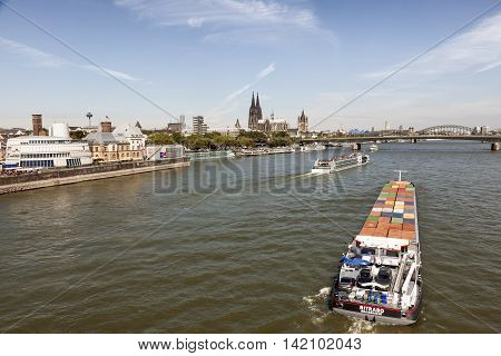 COLOGNE GERMANY - AUG 7 2016: Container ship and cruise ship at the Rhine river in Cologne Germany