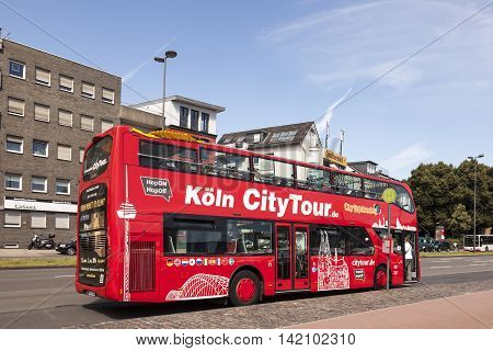 COLOGNE GERMANY - AUG 7 2016: Red sightseeing bus in the city of Cologne. North Rhine-Westphalia Germany