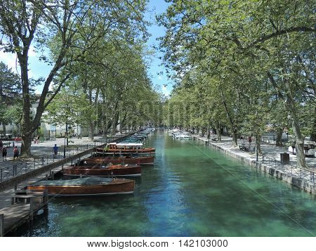 Boats moored at the Annecy lake channel