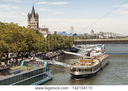 COLOGNE GERMANY - AUG 7 2016: Cruise ships at the Rhine river bank in the city of Cologne. North Rhine-Westphalia Germany