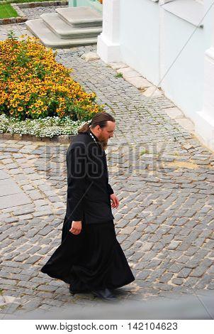 SERGIEV POSAD, RUSSIA - SEPTEMBER 06, 2012: Priest in Trinity Sergius Lavra Sergiev Posad Russia. UNESCO World Heritage Site.