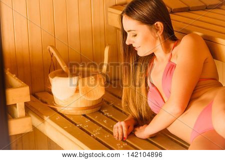 Woman Relaxing In Spa Sauna With Bucket. Wellbeing