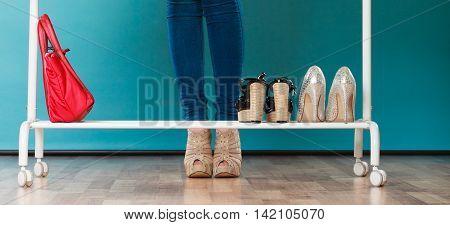 Woman Choosing Shoes To Wear In Mall Or Wardrobe