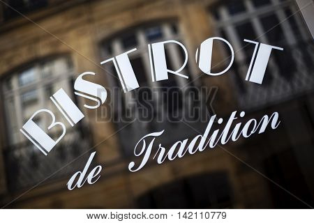 Reflection on the window of a vintage French bistro