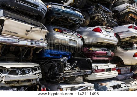 Indianapolis - Circa August 2016 - A Pile of Stacked Junk Cars - Crushed and Discarded Junk Cars Piled Up VIII