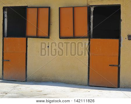 horizontal image of an orange and yellow stable