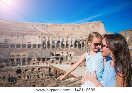 Happy family in Rome over Colosseum background