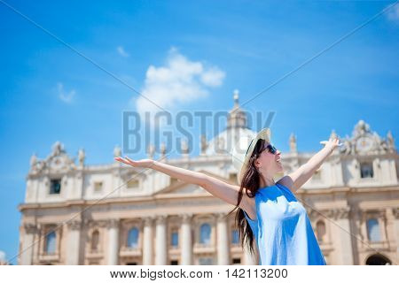 Happy tourist in Rome over St. Peter's Basilica church in Vatican city background