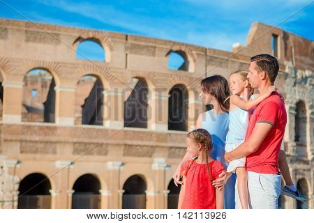 Happy family in Rome over Coliseum background