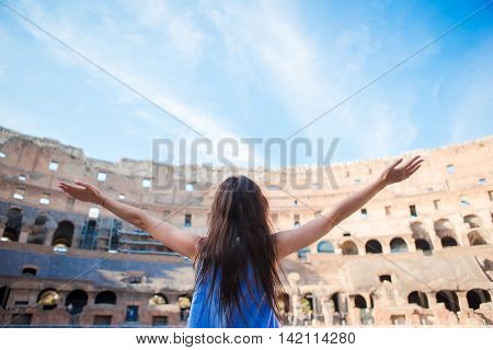 Happy tourist in Rome over Colosseum background