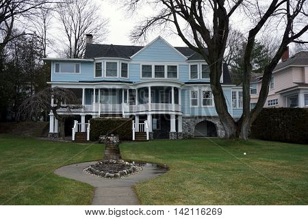 A large blue mansion on Beach Drive in Wequetonsing, Michigan.